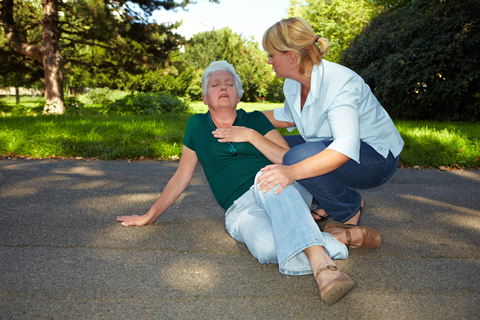 women giving first aid to older women